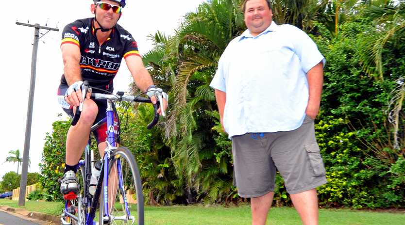 Bundaberg Cycling club committee member Sheldon Devantier apictured with Jason Templeman before he started his weight loss journey.