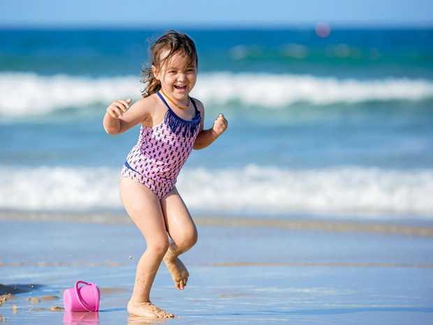 Estelle Todd has some fun at Rainbow Beach.