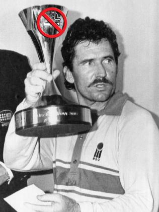 Allan Border holds aloft the Benson and Hedges World Series Cricket trophy in 1988.