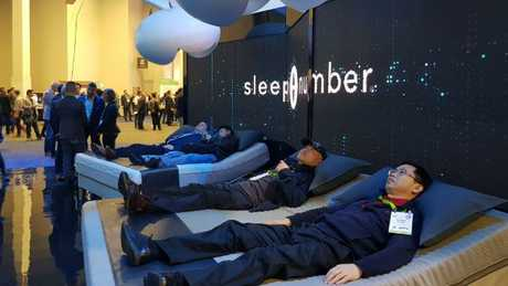 Weary CES visitors test out the amazing beds. Photo: Tanya Westthorp