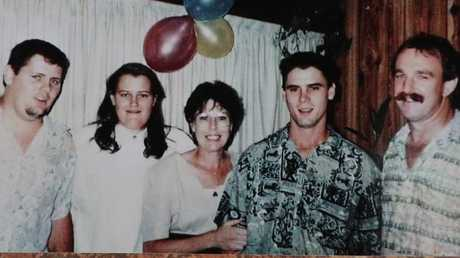 Jason (green shirt) and his family on his 21st birthday. Picture: supplied.