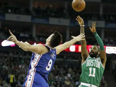 Kyrie Irving shoots over Dario Saric. (AP Photo/Kirsty Wigglesworth)