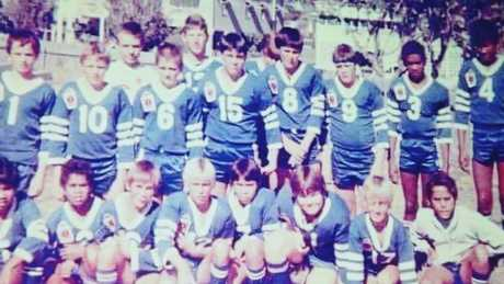 Jason and his football team. Picture: supplied.