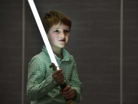 Finn Pickering learning the art of Lightsaber theatre. Star Wars day at the Toowoombsa Library. January 2018