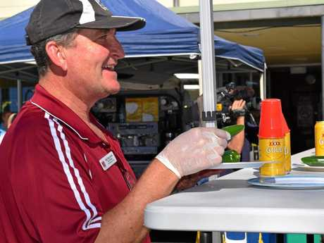 PCYC Branch manager sergeant Greg Jones hands out the chillis during the chilli-eating competition at the PCYC Chilli Festival last year.
