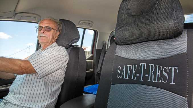 SAFETY FIRST: Inventor Chris Albert demonstrates his Safe-T-Rest headrests.