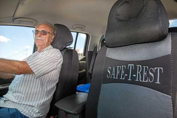 SAFETY FIRST: Inventor Chris Albert demonstrates his Safe-T-Rest headrests.