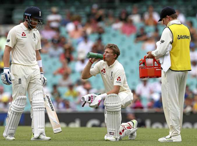 England's Joe Root, center, takes a knee while drinking during a break of play against Australia during the last day of their Ashes cricket test match in Sydney, Monday, Jan. 8, 2018. (AP Photo/Rick Rycroft)