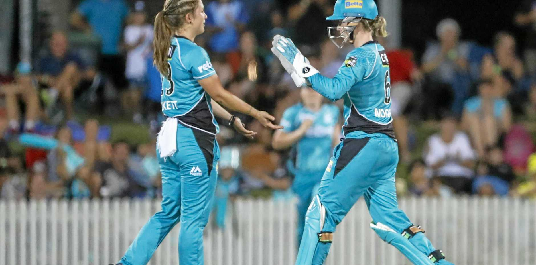 Hailed Burkett (left) of the Heat and Beth Mooney (right) of the Heat celebrate the wicket of Katie Mack of the Stars during the Womens Big Bash League (WBBL) cricket match between Brisbane Heat and Melbourne Stars at Harrup Park, Mackay on Friday, January 12.