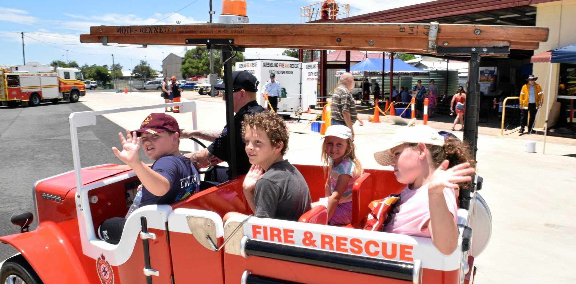 The kids get a ride in Little Squirt, driven by firefighter Dean Murphy.