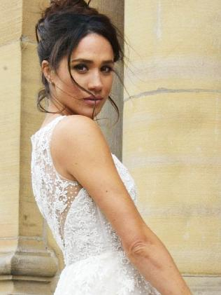 Meghan Markle as Rachel Zane in a wedding dress on the TV show Suits.