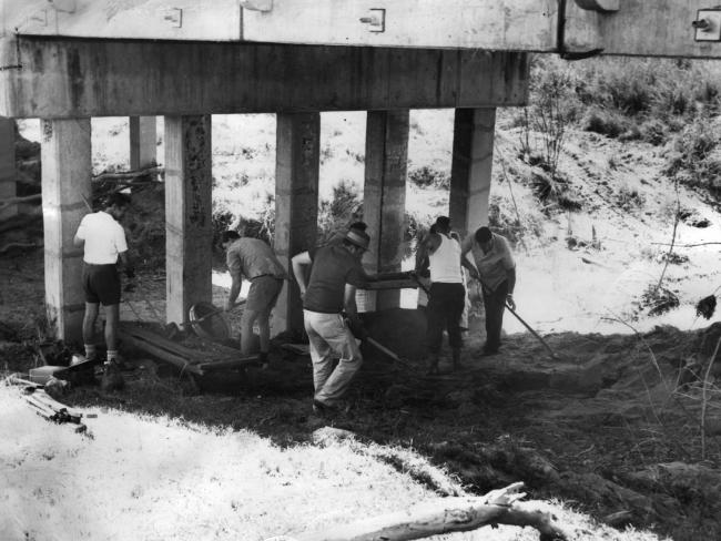 Police at the murder scene under Sensible Creek bridge in 1972, where only one of the girls was found.
