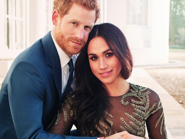 Britain's Prince Harry with fiance Meghan Markle, who is wearing a $95,000 Ralph & Russo dress. Picture: AFP