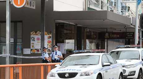 Officers at the scene of a fatal stabbing outside Hurstville Train Station.