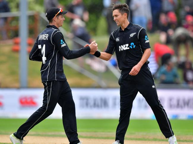 Mitchell Santner, left, with Trent Boult.