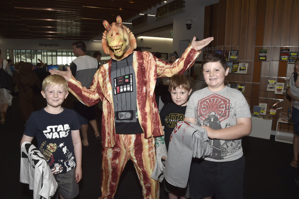 Meeting Jar Jar Binks (Cameron McLeod) are from left; Elliot Sense, 7, Logan Telford, 6, and Kaleb Telford, 10, Star Wars day at the Toowoombsa Library. January 2018