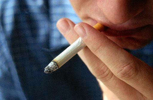 Smoker inhaling on cigarette