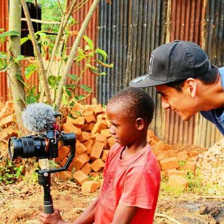 IN UGANDA: David Pierson teaches locals how to use his camera gear.