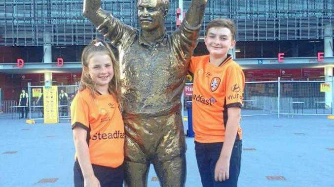 LEGEND: Bailey Jensen, 12, and his sister Charlee, 9, rubbing shoulders with King Wally Lewis.