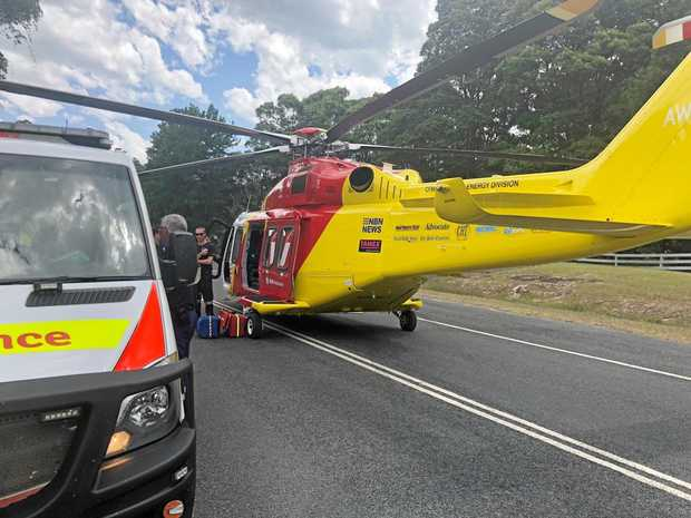 The Westpac Life Saver Rescue Helicopter at the scene of the crash on Tweed Valley Way this afternoon.