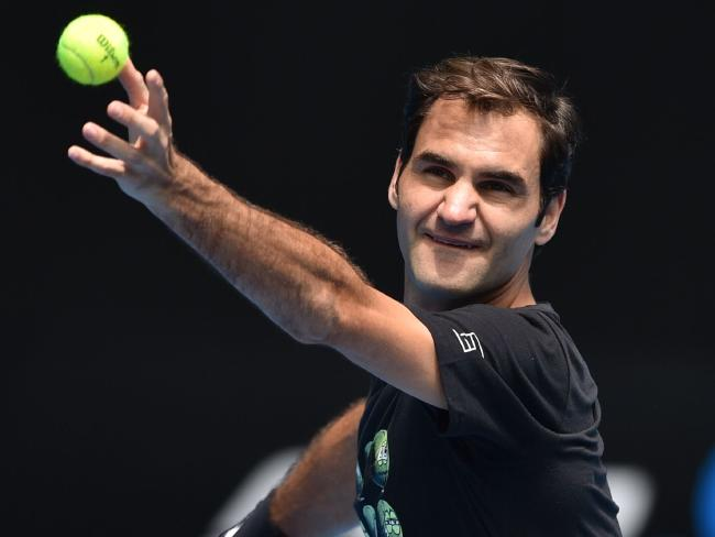 Federer practices his serving at Melbourne Park. Picture: AFP