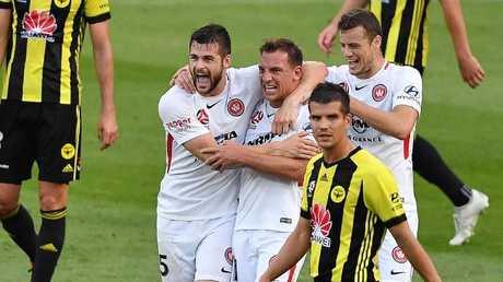 Brendan Hamill and Jerrad Tyson celebrate Brendan Santalab's goal against Wellington.