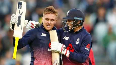 Roy lifts heis bat after scoring a century to the delight of teammate Joe Root. Picture: Getty Images