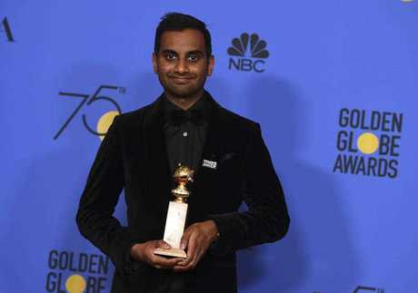 Aziz Ansari at the Golden Globes wearing a Times up pin.