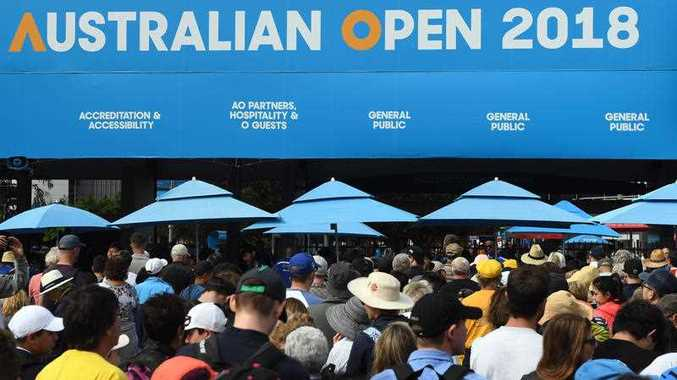 Fans queue at the gate for the Australian Open tennis tournament, Monday, January 15, 2018.