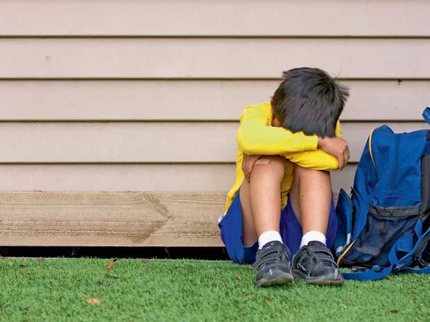 HELPING HAND: The Kids Helpline shares tips with parents about how to spot the signs of bullying.