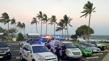 Emergency services respond to reports of people in trouble in the water at Bargara.