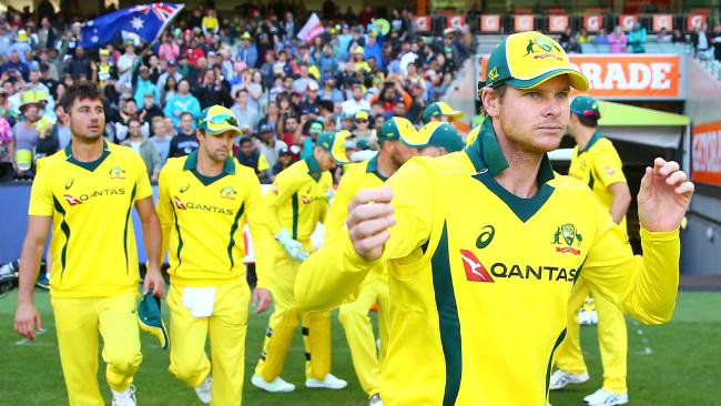 MELBOURNE, AUSTRALIA — JANUARY 14: Steven Smith, captain of Australia sleads his side onto the field during game one of the One Day International Series between Australia and England at Melbourne Cricket Ground on January 14, 2018 in Melbourne, Australia. (Photo by Scott Barbour/Getty Images)