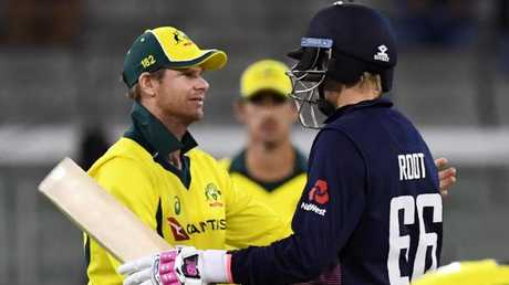Steve Smith shakes hands with Joe Root.