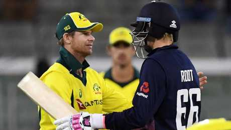Steve Smith shakes hands with Joe Root after England defeated Australia in their ODI played at the MCG