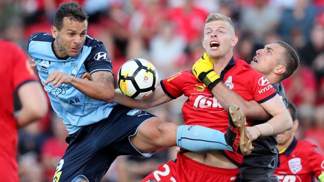 Sydney FC striker Bobo clashes with Adelaide's Jordan Elsey. Picture: AAP