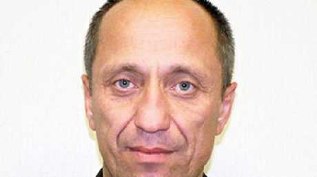 Mikhail Popkov picked up victims and drove them in his police car to forests where he raped and then strangled, axed or stabbed them to death. Picture: CEN/Australscope