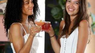 Pauline Lefur, 24, (right) with a Flower Power cocktail and Jazmin Webb, 23, with a Sunburn. Picture: Jonathan Ng