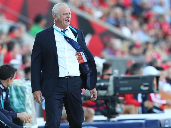 Graham Arnold revs up his men from the sideline in Adelaide. Picture: AAP