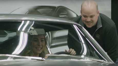 Molly McQueen gets behind the wheel of her grandfather's Mustang in an emotional reunion. Picture: Supplied.