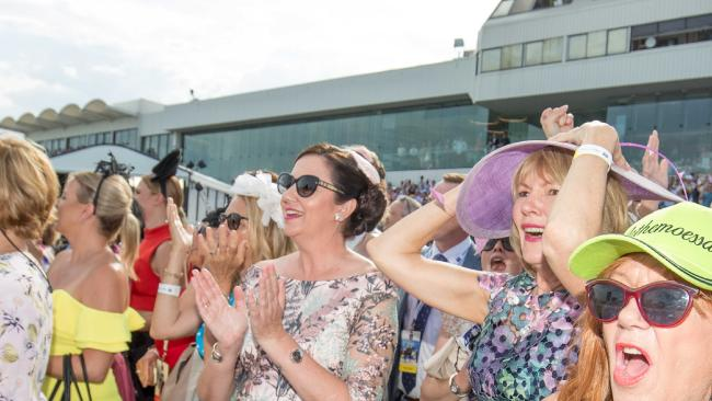 Queensland Premier Annastacia Palaszczuk (centre) with Magic Millions co-owner Katie Page (right, with her hands on her hat) cheer on horses at the Magic Millions race day at Gold Coast Turf Club Pic: Luke marsden