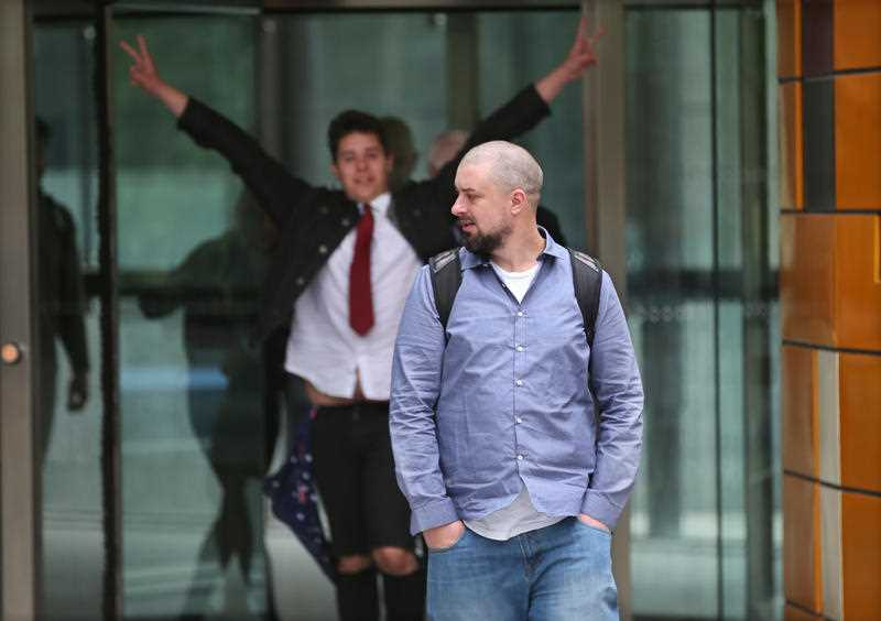 Far-right activist Neil Erikson leaves the Federal Court in Melbourne, Monday, January 15, 2018. Erikson appeared before the Federal Circuit Court on Monday after he breached court orders by failing to hand back Toll uniform items, after they were worn in United Patriots Front videos - including one where former senator Sam Dastyari is ambushed at a Melbourne pub.