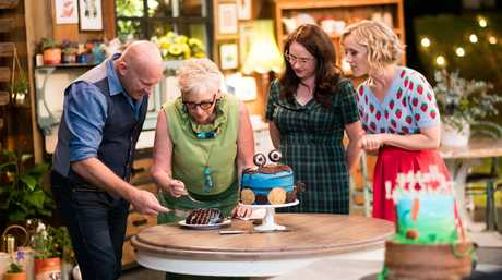 Great Australian Bake Off judges Matt Moran and Maggie Beer inspect a Cookie Monster-inspired cake as hosts Mel Buttle and Claire Hooper watch on in the season three premiere.