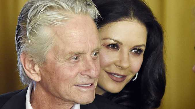 Catherine Zeta-Jones is standing by her husband, Michael Douglas.
