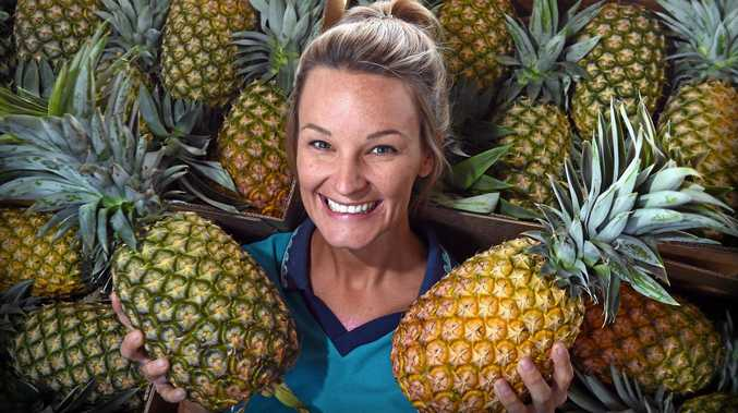 SWEET HARVEST: Rachel Erbacher of Erbacher's Fruit and Vegetables shows off some pineapples as the local season kicks off.