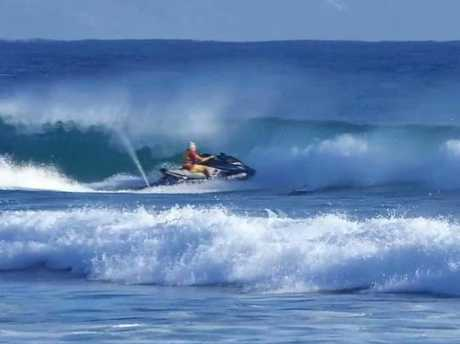 A STAND up paddleboarder has narrowly escaped being cleaned up by a passing jet skier at Noosa.