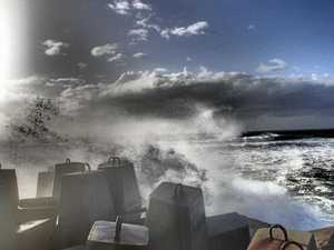 PHOTOS: Beaches blasted by 60km/h winds, 5.6m swell