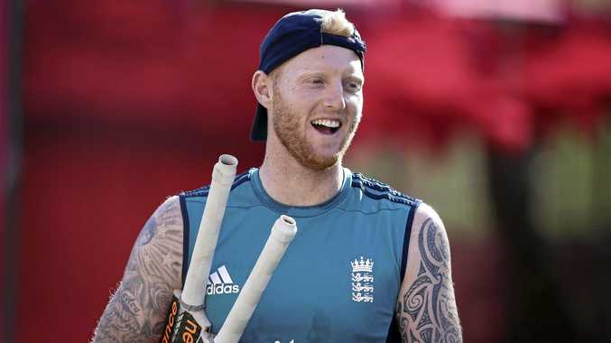 Ben Stokes carries two bats as he gets ready for a stint in the nets.