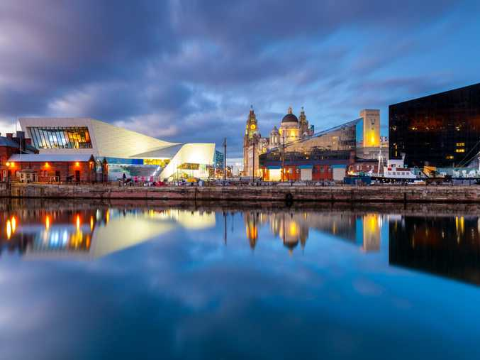 LIVERPOOL LIFE: Iconic landmarks on the Liverpool waterfront, taken at dusk; the Beatles Story museum in Albert Dock; and a statue of John Lennon outside the historic Cavern Club.