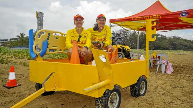 SOMETHING IN THE AIR: Kathy Singh and Kim O'Neill will be looking forward to having the old Tannum Sands surf lifesaving trailer replaced, thanks to a donation from the Fire Brigade.