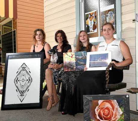 Uki Artists Darci McElroy, Paula Peach, Courtney Tartan and Josie Thacker display some of their artwork ahead of the upcoming art exhibit.